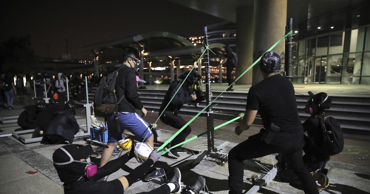 AP Photos: University a battleground in Hong Kong protests